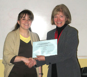 Dr Alanna Stanley receiving her Certificate of Completion from Emeritus